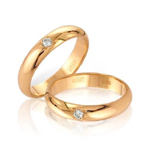 Кольца обручальные с бриллиантом
